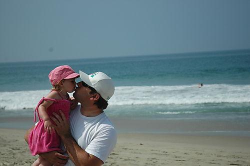 Brian-melania-beach-kiss