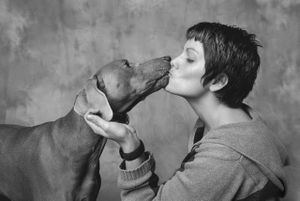 Dog_kissing_owner